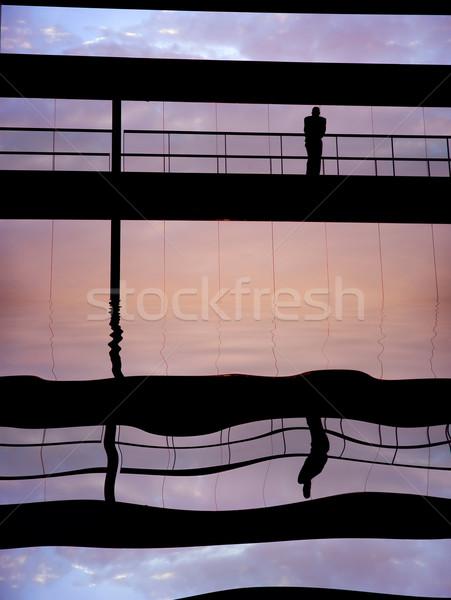 Solo trabajador dentro edificio silueta puesta de sol Foto stock © zittto