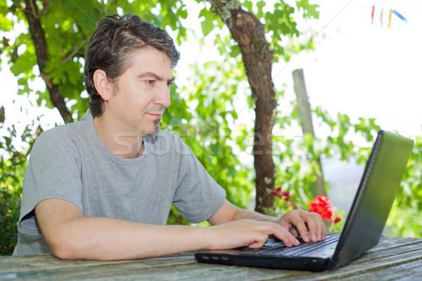 çalışma adam oturma açık dizüstü bilgisayar bilgisayar Stok fotoğraf © zittto