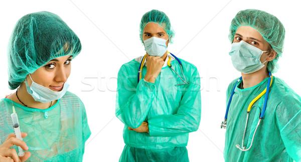 Artsen drie jonge geïsoleerd witte arts Stockfoto © zittto