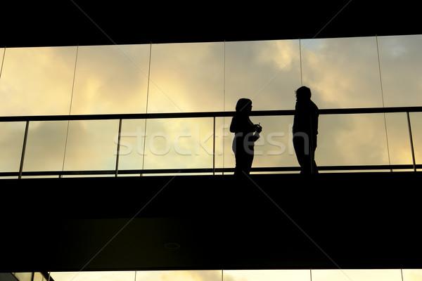 Toplantı çift modern bina ofis Bina gün batımı Stok fotoğraf © zittto