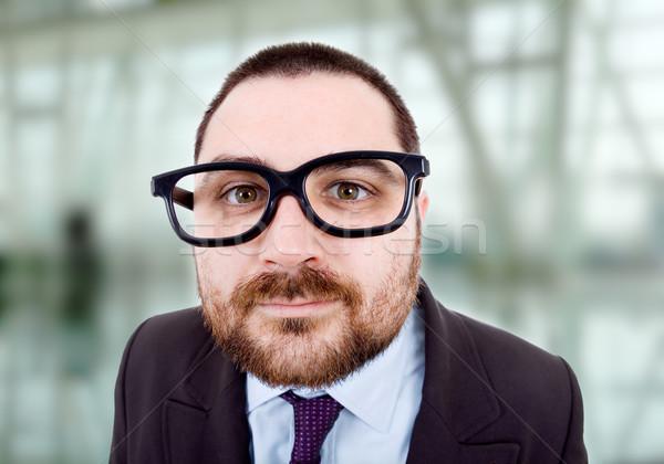 Stupido giovani uomo d'affari ritratto ufficio sorriso Foto d'archivio © zittto