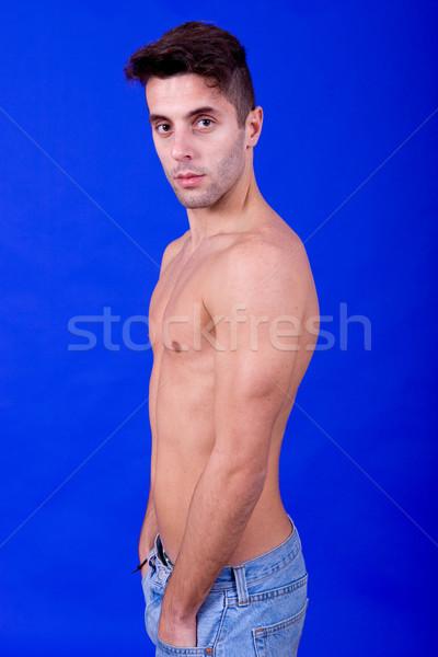 Top-less jóvenes casual hombre azul feliz Foto stock © zittto