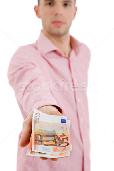 Geld jonge toevallig man aanbieden focus Stockfoto © zittto