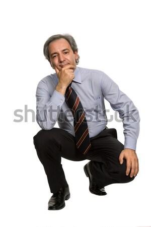 сидящий задумчивый зрелый бизнесмен изолированный белый Сток-фото © zittto