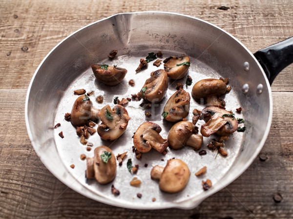 rustic pan sauteed mushroom Stock photo © zkruger