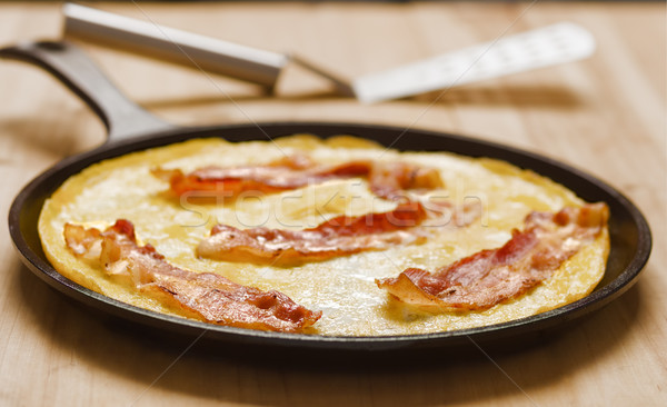 rustic fried bacon omelette Stock photo © zkruger