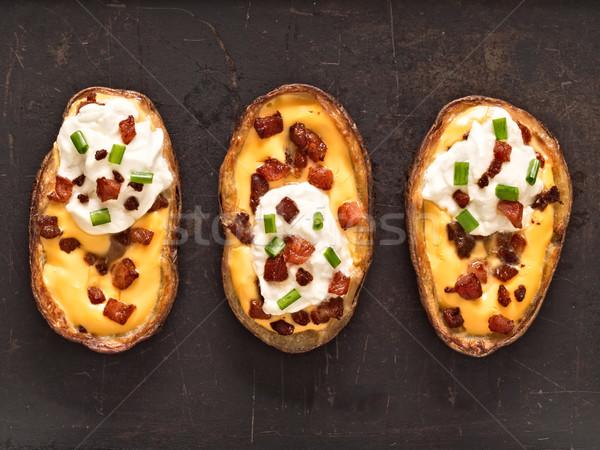 rustic baked potato skin Stock photo © zkruger