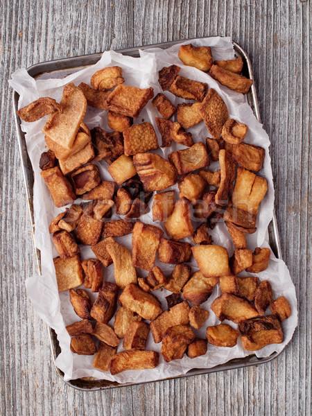 rustic deep fried crispy pork rind Stock photo © zkruger