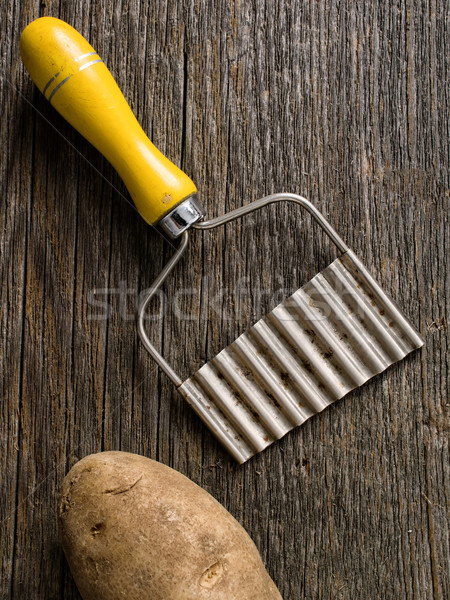 hand crinkle cut potato chipper Stock photo © zkruger