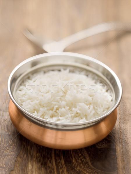Indian gestoomd basmati rijst kom Stockfoto © zkruger