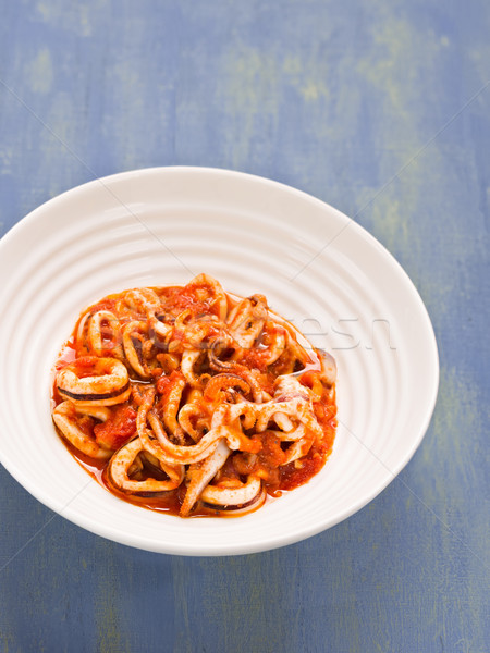rustic italian calamari in spicy tomato sauce Stock photo © zkruger