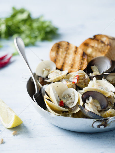 rustic italian vongole clams in white wine sauce Stock photo © zkruger
