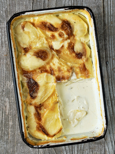 rustic golden scalloped potato gratin dauphinois Stock photo © zkruger