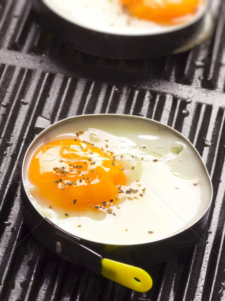 Frit oeufs grill métal poulet Photo stock © zkruger