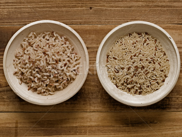 rustic cooked and uncooked unpolished brown rice Stock photo © zkruger