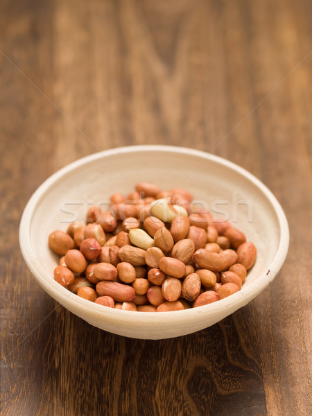 rustic raw uncooked peanuts Stock photo © zkruger