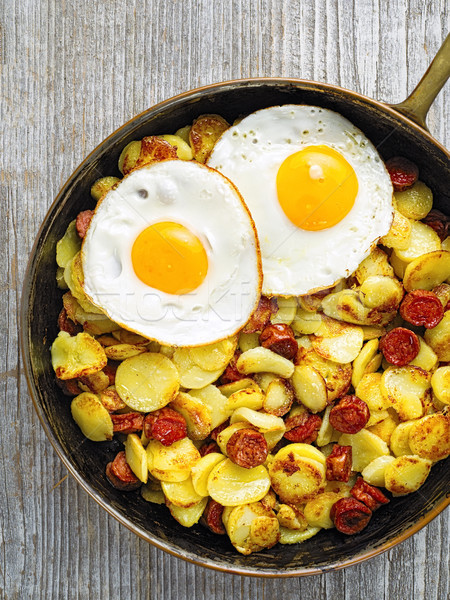 pan of rustic sausage potato hash Stock photo © zkruger