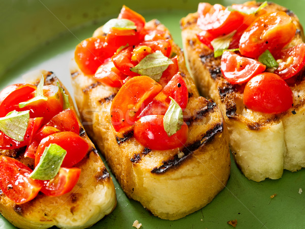 Rustik İtalyan bruschetta ekmek domates Stok fotoğraf © zkruger