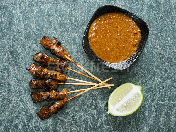 rustic indonesian satay meat skewer Stock photo © zkruger