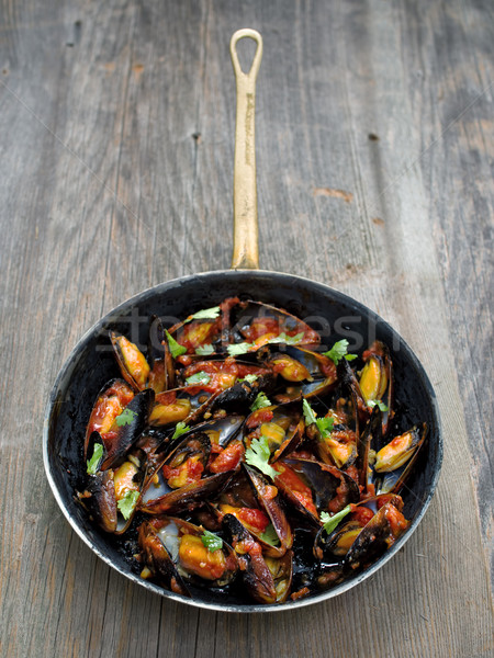 Rústico negro salsa de tomate color mariscos Foto stock © zkruger