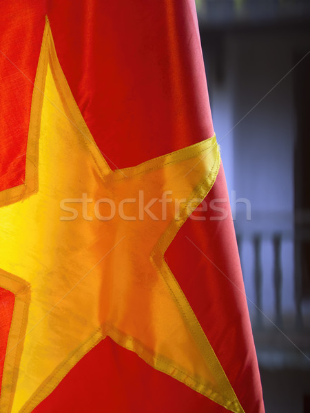 red vietnamese flag with buildings background Stock photo © zkruger