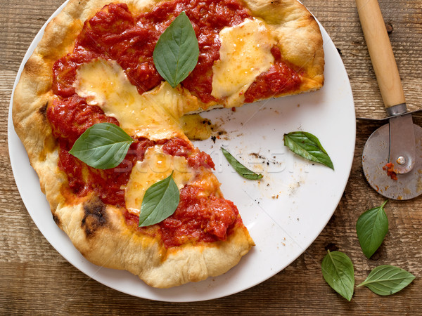 rustic italian pizza margherita Stock photo © zkruger
