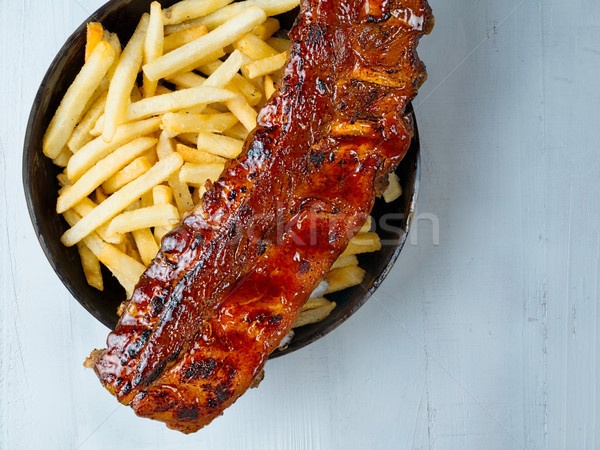 Rustico barbecue carne di maiale costola carne Foto d'archivio © zkruger