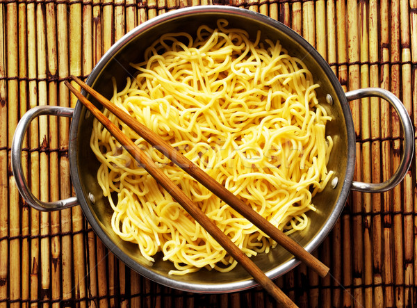 wok of yellow noodles Stock photo © zkruger