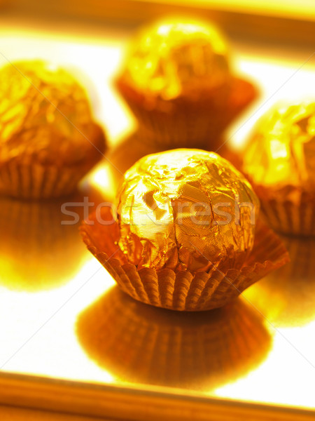 candy in gold wrapper Stock photo © zkruger