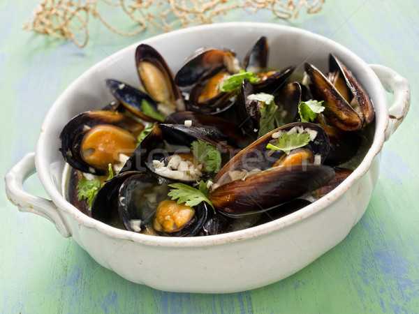 rustic black mussel in garlic white wine sauce Stock photo © zkruger