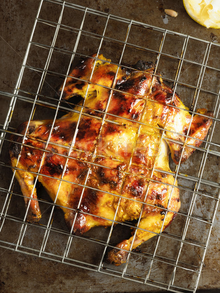 rustic barbecued whole chicken Stock photo © zkruger