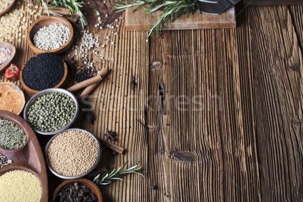 Especias establecer colorido diferente bolos mesa de madera Foto stock © zolnierek