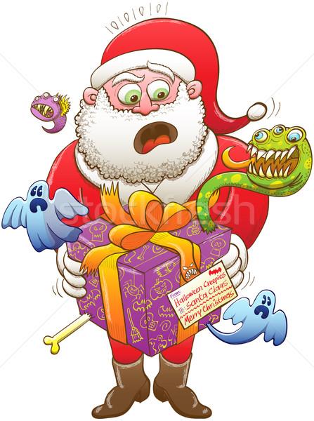 Santa Claus receiving an odd Xmas present from Halloween creatures Stock photo © zooco