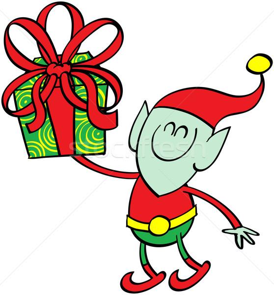 Green elf giving a Christmas present Stock photo © zooco