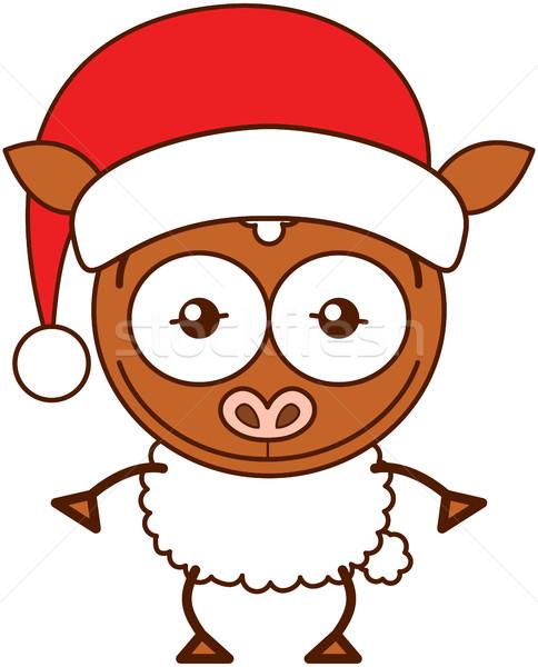 Cute sheep wearing Santa hat and celebrating Christmas Stock photo © zooco