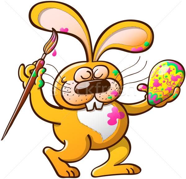 Szép nyuszi festmény húsvéti tojás rendetlen citromsárga Stock fotó © zooco