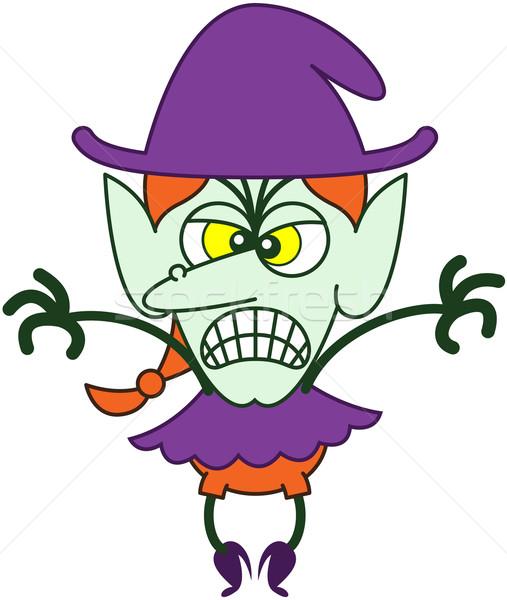 Rabbioso halloween strega scary viola vestiti Foto d'archivio © zooco