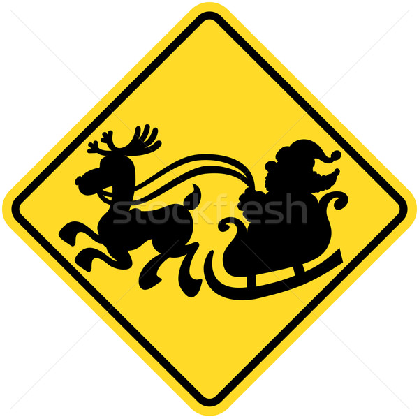 Stock photo: Yellow warning sign informing that Santa Claus will possibly cross the road in his sleigh pulled by