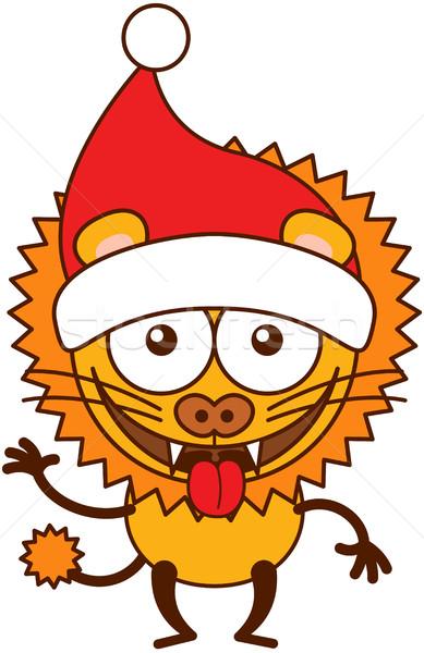 Aranyos oroszlán visel mikulás kalap ünnepel Stock fotó © zooco