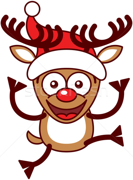 Christmas reindeer wearing a Santa hat and jumping Stock photo © zooco