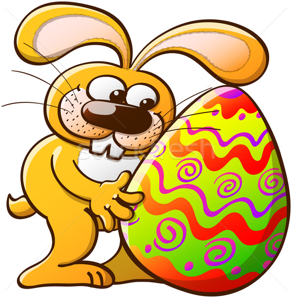 Easter Bunny Hugging his Decorated Egg Stock photo © zooco