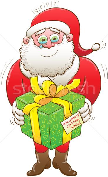 Weeping Santa receiving a Christmas present Stock photo © zooco