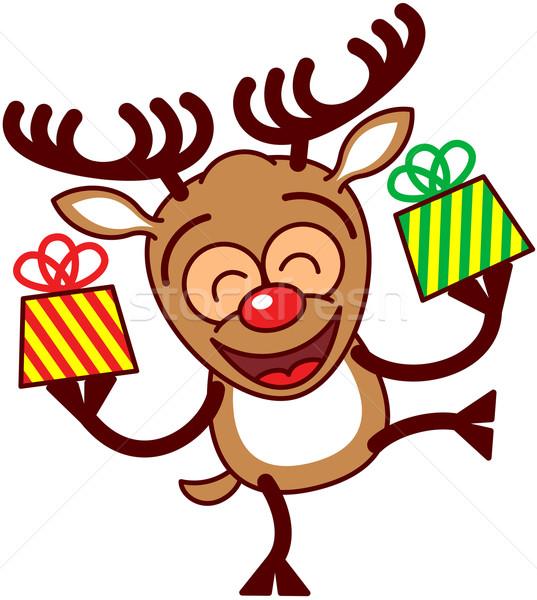 Neşeli ren geyiği Noel hediyeler mutlu kahverengi Stok fotoğraf © zooco