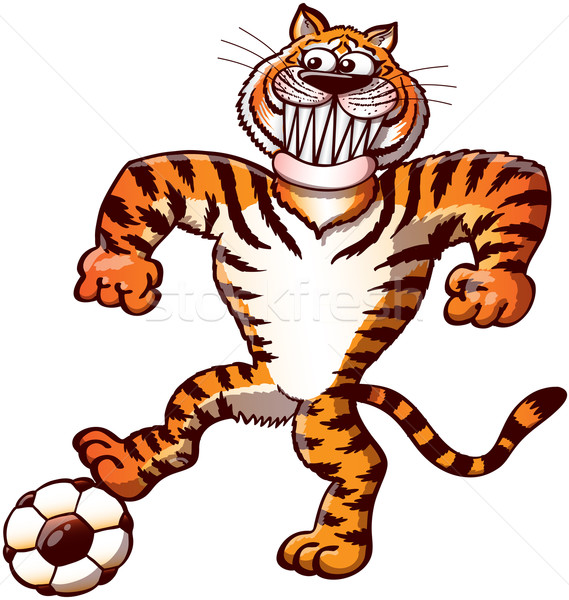 Brave tiger stepping on a soccer ball and preparing to kick it Stock photo © zooco