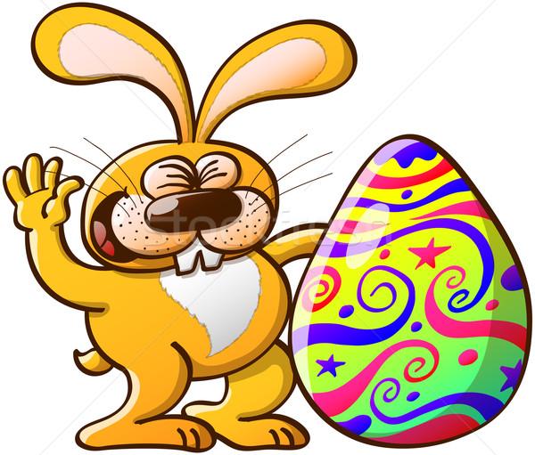 Joyful Easter Bunny and Enormous Egg Stock photo © zooco