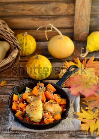 the baked chicken with pumpkin in a pig-iron frying pan  Stock photo © zoryanchik