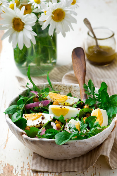 Crispy Chickpea and Arugula Salad. Stock photo © zoryanchik