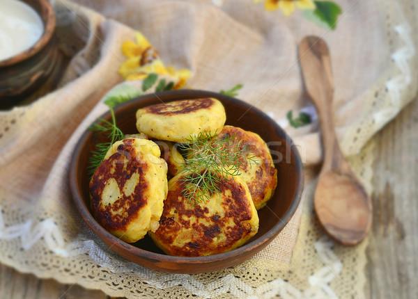 potato patties with fried  bacon  and onions. Stock photo © zoryanchik