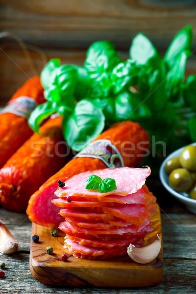 The cut salami sausage on a chopping board Stock photo © zoryanchik