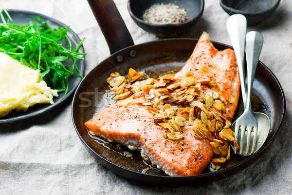 Trout sauted in butter with almonds . Stock photo © zoryanchik